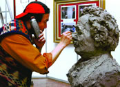 p. 126 – Yuan sculpting while on phone